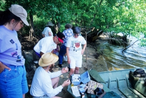Citizen volunteers learn water sampling techniques on Mississippi River, 1998.